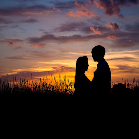 Sunset by John  Pemberton - People Couples ( love, sunsets, silhouette, sunset, couple,  )