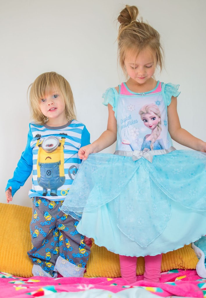 Kids in cartoon pyjamas
