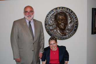 Photo: President J. David Arnold welcome Michelle Sullivan of the Caterpillar Foundation to Eureka College, June 5, 2012.