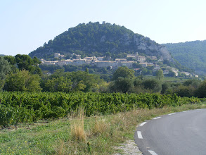 Photo: We approach our next destination, the hillside village of Séguret, with remains of the medieval castle at the top.