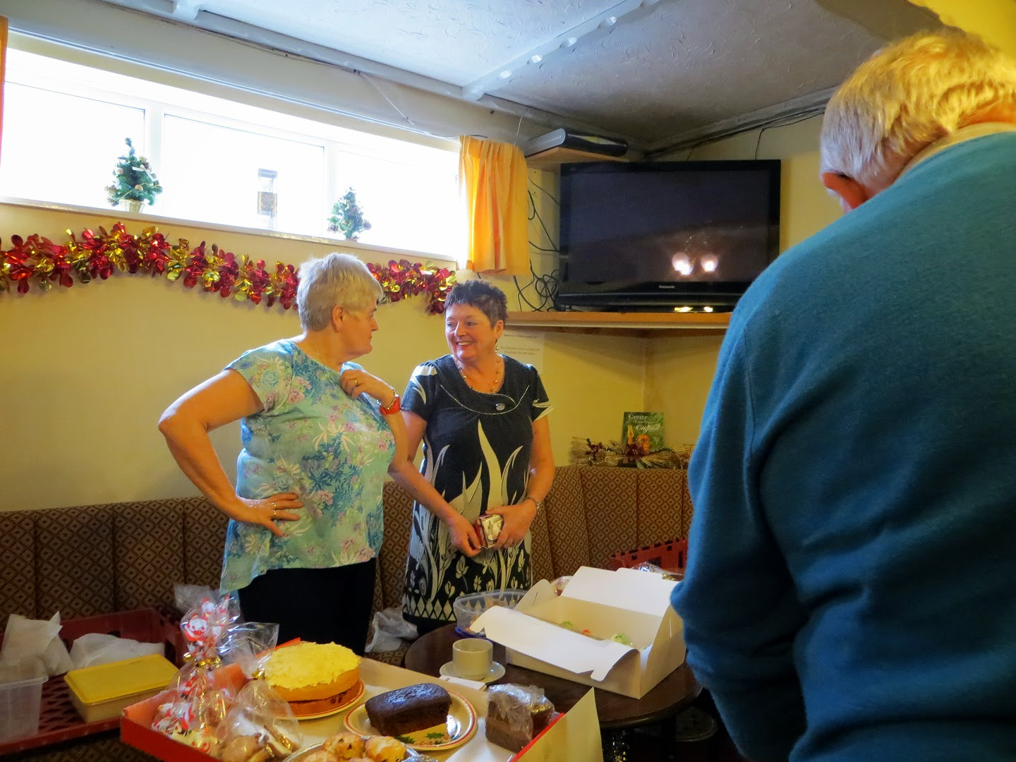 Photo: Mary & Wyn selling Seamus a cake or two