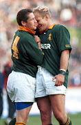 A file photo of former South African rugby captain Franscois Pienaar (R) congratulating James Small (L) on his tries against the British Lions at Ellis Park in Johannesburg. South Africa.