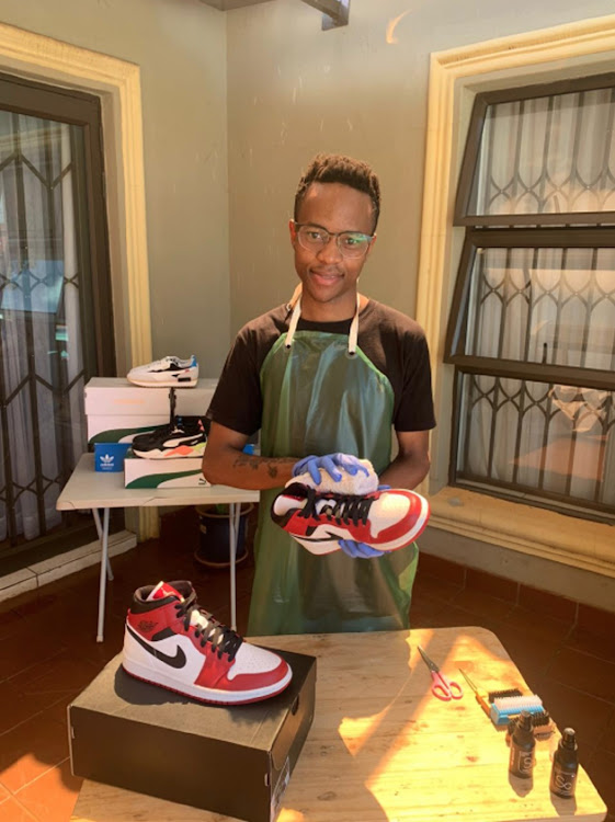 Kabelo Moteme, 21, the owner of Dr Shine-A-Lot sneaker cleaning company.