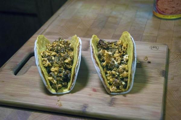 Divide the egg/chorizo mixture among the taco shells.