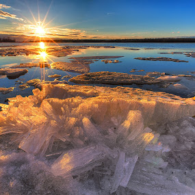Chrystalburg by Jerry Boyden - Landscapes Sunsets & Sunrises ( iceberg, intracoastal waterway, boyden galleries, waterscape, winterscape, landscape photographer, rock, canon eos 5d mark iii, frozen, landscape, sun rays, mirror, st. lawrence seaway, massena, blue sky, cold, ice, shoreline, st. lwrence river, clouds, colors, new york, rays, riverbank, boyden photography, red, nature photographer, bay, blue, sunset, vibrance, photographer jerry boyden, snowscape, brilliant, jerry boyden, st.lwrence county, river bank )