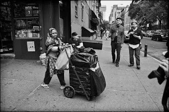 Photo: I was so happy to capture this woman. I wish that I had also captured her husband. She pushed the cart and he walked ahead of her.  In the Background is +Bastian Staude left, +Chris Gachot center and +Dave Ortiz on the right. As well, I think that the camera in the foreground is +paula layton. #NYCphotowalkers