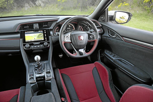 The interior features an excellent driving position and typical Type-R trim. Picture: HONDA