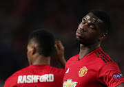 Manchester United midfielder Paul Pogba reacts during theh Uefa Champions League quarterfinal first leg encounter against Barcelona at Old Trafford in Manchester on April 10 2019.