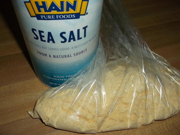 Pour cornmeal and salt into plastic food bag; close opening & shake to mix.