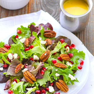 Baby Greens Salad with Pecans, Pomegranate, Goat Cheese & Mango Dressing.