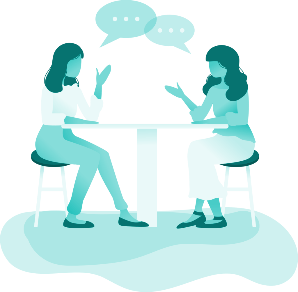 two people talk at a table