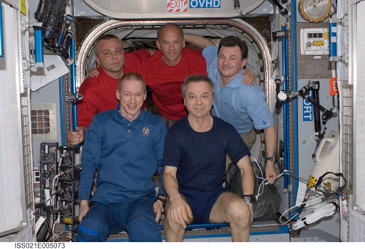 View of Expedition 21 Crew Members posing for a photo in the Node 2