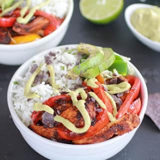 Fiesta Chicken + Cilantro Lime Rice Fajita Bowl with Avocado Chipotle Crema. Recipe
