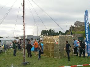 Photo: radio mast and golden art cube near austrian village