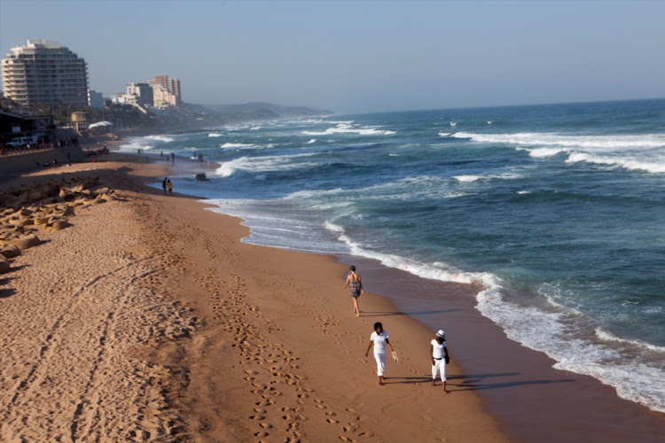 People seen walking on the beach at Umhlanga, in February 2012.