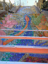 Photo: Detail of salamander (blue body with red stripe) extending up the fifth and fourth flights of steps (from top) on the Hidden Garden Steps (16th Avenue, between Kirkham and Lawton streets in San Francisco's Inner Sunset District) installed on October 30, 2013. KZ Tile workers finished installing more than 50 pieces of the 148-step ceramic-tile mosaic designed and created by project artists Aileen Barr and Colette Crutcher. For more information about this volunteer-driven community-based project supported by the San Francisco Parks Alliance, the San Francisco Department of Public Works Street Parks Program, and hundreds of individual donors, please visit our website at http://hiddengardensteps.org.