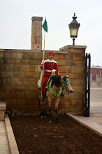 Photo: The guard to the Mausoleum of Mohamed V and the Hassan Tower