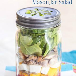 Mango Chicken Mason Jar Salad with Lemon Blueberry Chia Vinaigrette.