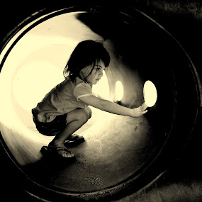 On The Inside by Vanessa Latrimurti - Babies & Children Children Candids ( playground, eyelashes, black and white, play, round, youth, drama, contrast, looking, child, circles, girl, summer, innocence, locals slippers, small, tunnel )