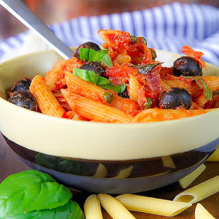 TUNA PASTA with olives capers and tomato sauce.