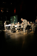 Photo: Soldiers of the 34th Infantry Division Band perform during the 34th Red Bull Infantry Division Departure Ceremony at Roy Wilkins Auditorium in St. Paul, Minn., Feb. 10, 2009.