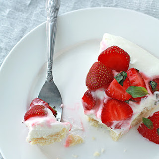 A Summer Cookie Tart Topped With Basil Strawberries And Yoghurt Cream