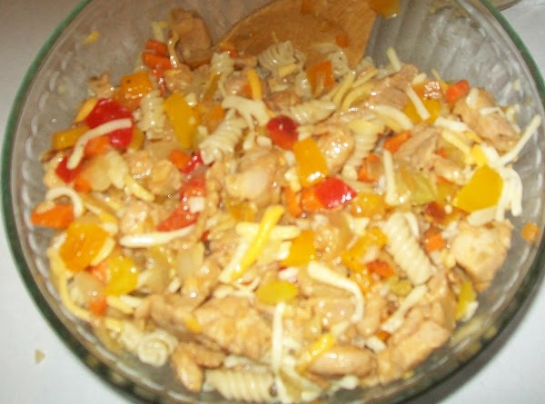 Add the pasta & 1 cup of the Mexican cheese to the chicken and...