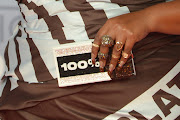 Like the dress she wore to the Brit Awards, singer Lizzo's manicure was inspired by Hersey's chocolate.
