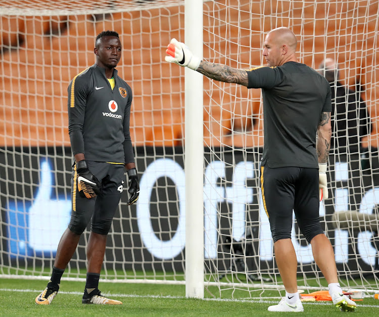 Kaizer Chiefs goalkeeper Bruce Bvuma (L) during a warm up session with his goalkeeper coach Lee Baxter before a match.