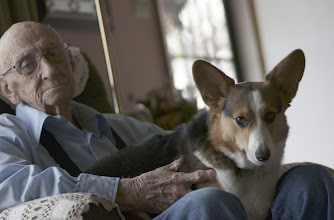 Photo: Dick Grimm relaxing with his new Corgi. Photography by Alan McClelland.
