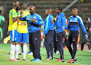 Mamelodi Sundowns coach Pitso Mosimane and his players in a discussion during the match.