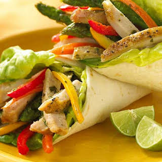 Pork Loin Tortilla Wraps With Roasted Vegetables And Citrus Mint Dressing.