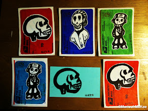 "Photo: Untitled: T9A16 Total Number of Pieces: 6 {(3) Skulls, (2) Headphone Jack and (1) 1121 Skelly.} Medium: Sharpie markers on mailing labels and paper. Each is signed on the front. Sizes: 3 ¼ x 4½"" and 3 x 5"" or 8 cm x 11 cm and 8 cm x 13 cm (Approximate measurements). ©Marisol McKee http://Triple9Art.com/."