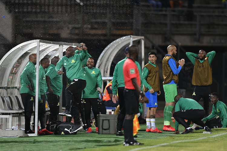 Mamelodi Sundowns head coach Pitso Mosimane kicks the bottle of water after Thapelo Morena missed a goal during the CAF Champions League match between Mamelodi Sundowns and Lobi Stars at Lucas Moripe Stadium on March 09, 2019 in Pretoria, South Africa.