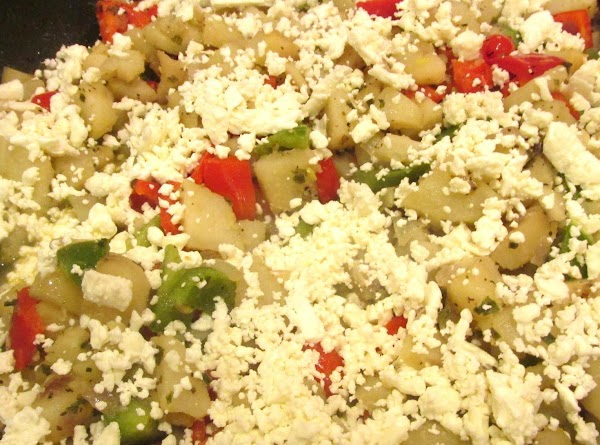 Add the crumbled Feta and shredded mozzarella if using and stir to blend with...