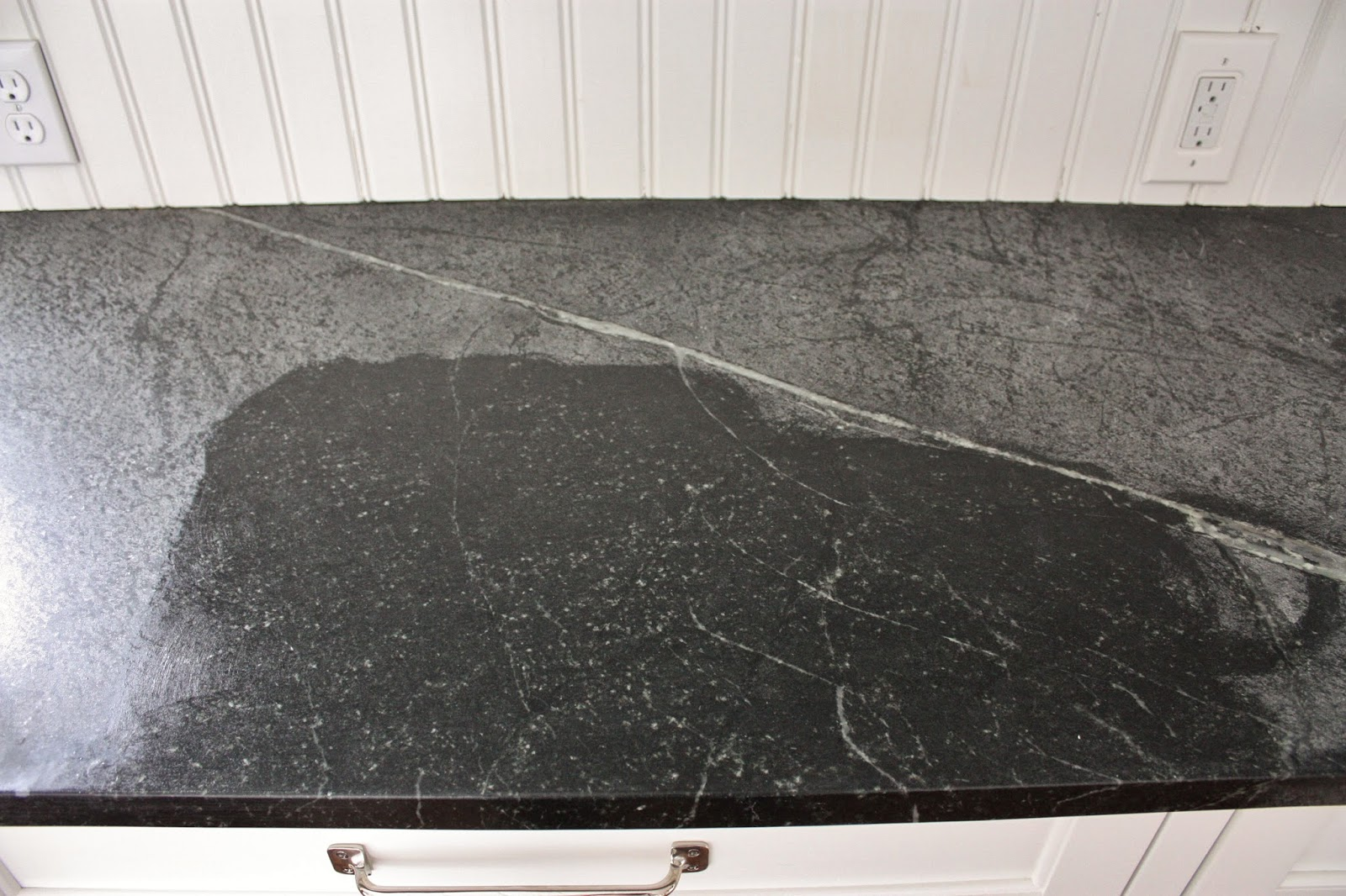 black soapstone countertop being rubbed with mineral oil