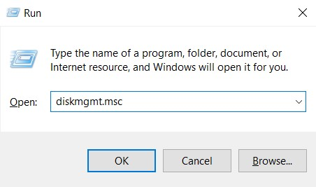 Open the Run utility (Windows + R keys), type in diskmgmt.msc and click Ok