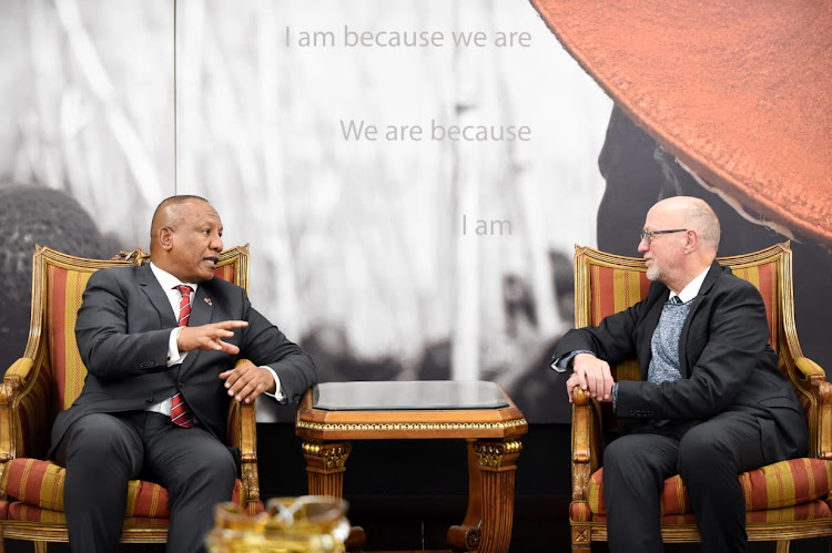 Madagascar Prime Minister Christian Ntsay is welcomed to the country by minister of tourism Derek Hanekom.