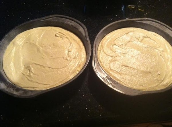 PREHEAT OVEN TO 350  POUR EQUAL AMOUNTS OF BATTER INTO EACH GREASED N...