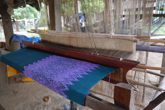 Photo: Village ladies spend their free time doing lots of weaving