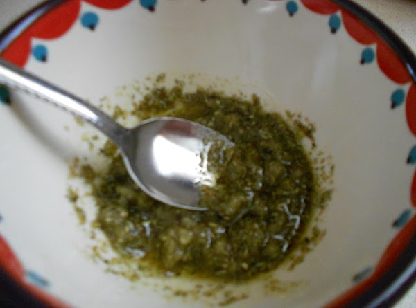 In a small bowl, mix the herbs, garlic, olive oil, salt and pepper.
