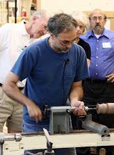 """Photo: Now we're getting down to business -- our demonstrator for the evening, Ed Kelle, visiting from his home on Long Island, NY, begins work on one of his signature """"blossom"""" forms."""