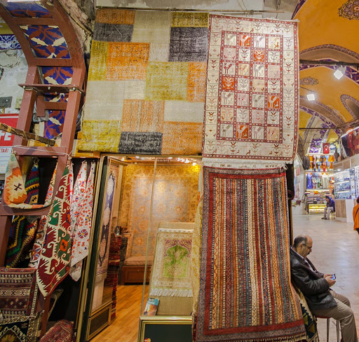modern-turkish-carpets.jpg - Modern Turkish carpets line the entrance to a shop in Istanbul's Grand Bazaar.
