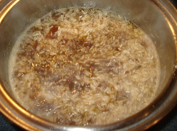 Add rice. Stir. Cover. Remove from heat.  Let stand about 10 minutes or...
