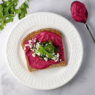 Beet and Basil Pesto Toast with Arugula and Goat Cheese.