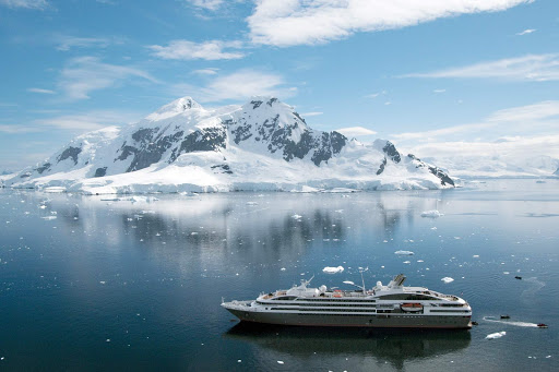 Le Boreal sails past the Aitcho Islands in the South Shetland Islands, Antarctica.