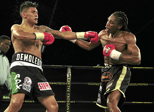 Thulani Mbenge exchanges leather with Diego Cruz at Emperors Palace on Saturday.