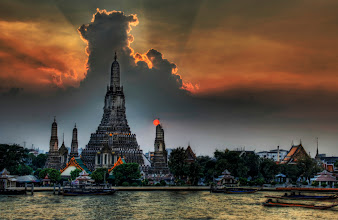 """Photo: One Night in Bangkok  This picture is of Wat Arun, a famous Buddhist temple in Thailand. I took it from a really cool little Italian restaurant across the way that is attached to a boutique hotel named """"Arun Residence"""". I will stay at this place next time - be sure to get the balcony room at the top if you come... it's just over $100 a night and is the best (and only) view of this temple in Bangkok.  from Trey Ratcliff at www.stuckincustoms.com"""