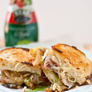 Gruyere, Ham, and Caramelized Onion Grilled Cheese with Apple Balsamic Glaze.