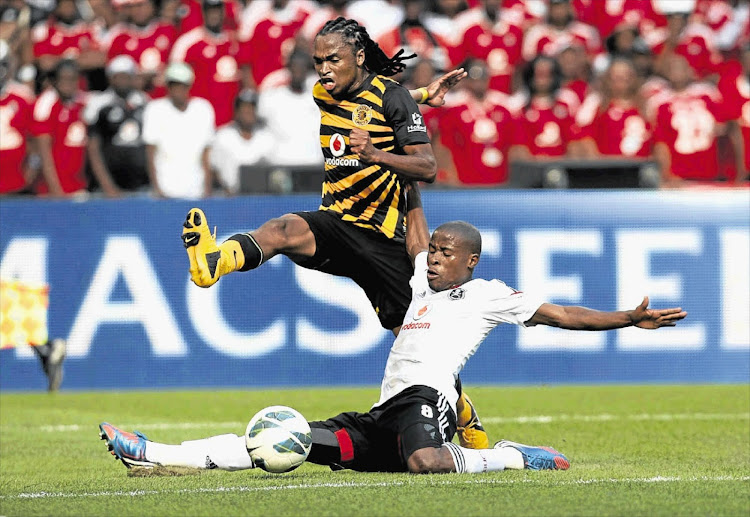 Siphiwe Tshabalala of Kaizer Chiefs leaps over Orlando Pirates' Thabo Matlaba during the Soweto Derby played at the FNB Stadium. (File photo)